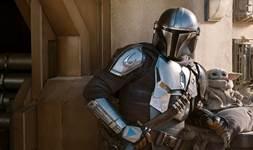 The Mandalorian silver armor and Baby Yoda